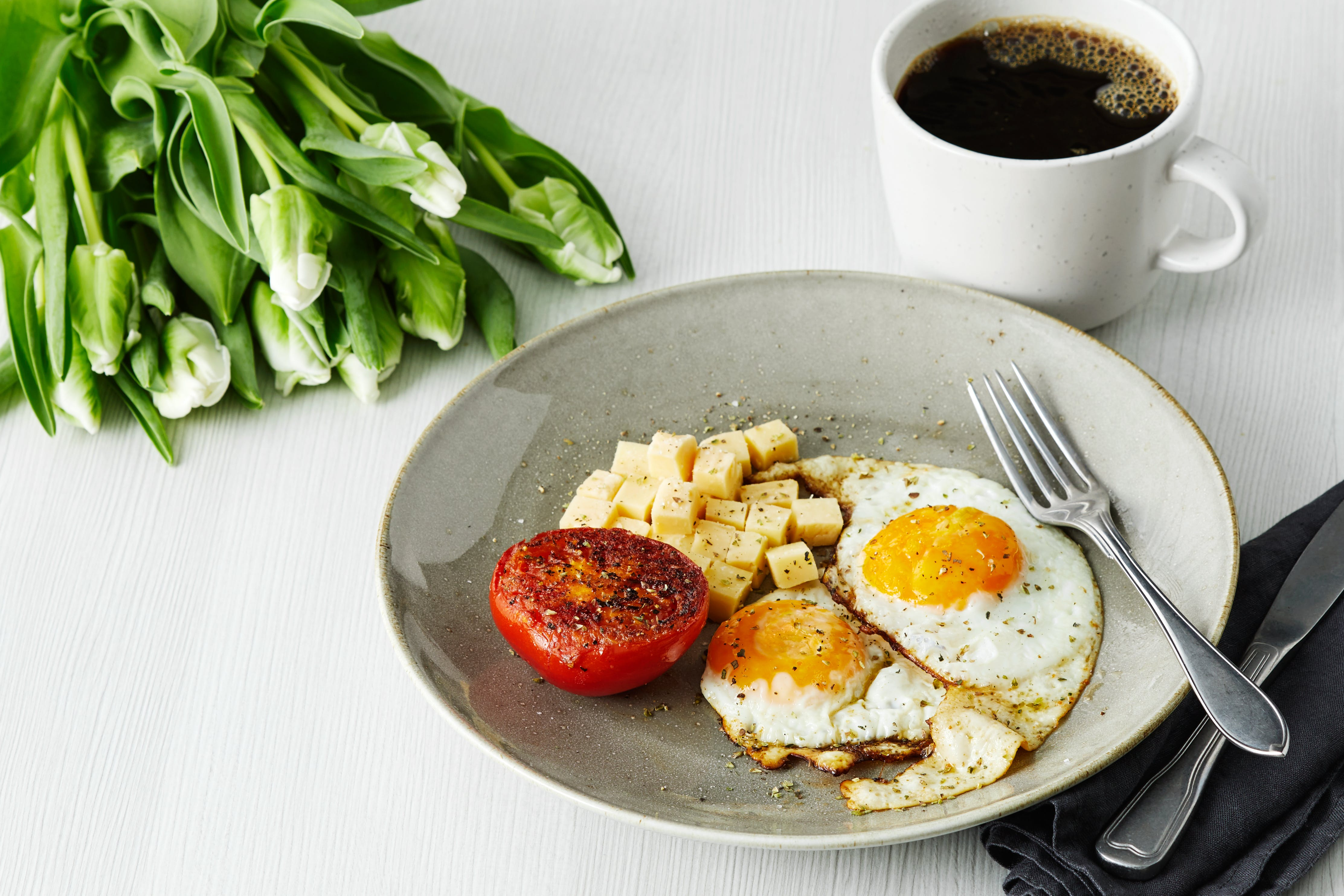 Keto breakfast with fried eggs tomato and cheese
