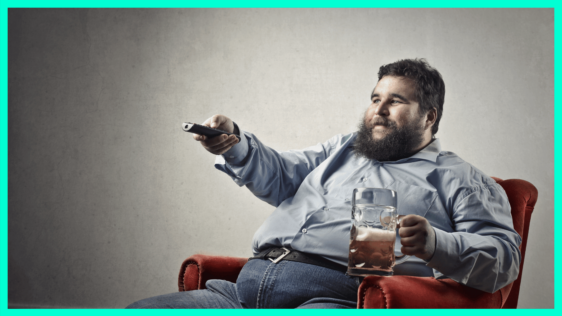 man sitting on couch with beer and tv remote