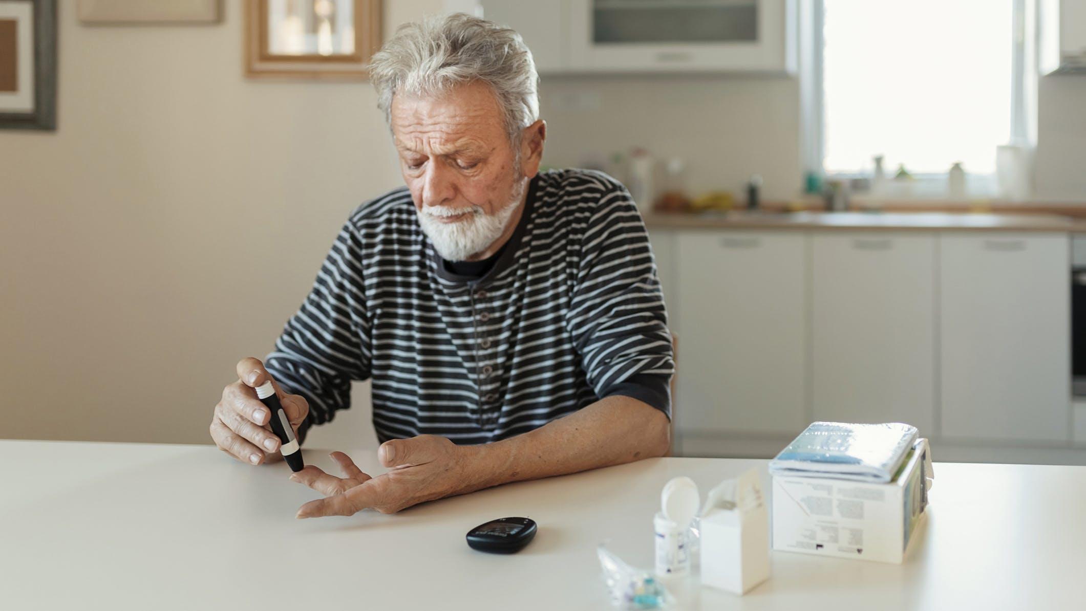 Senior man with glucometer
